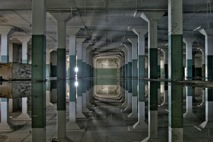 Abandoned building that flooded, creating a surreal and perfect water reflection via @AbandonedPics