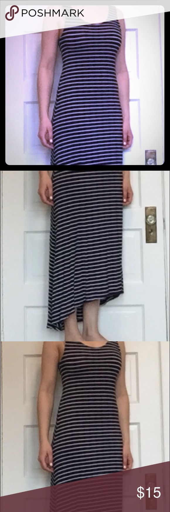 Navy blue and white stripped maxi dress Lightweight navy blue and white stripped maxi dress. High-low style. Fit is closer to S than M. 95% Vilcose, 5% Spandex. Like new! Dresses Maxi