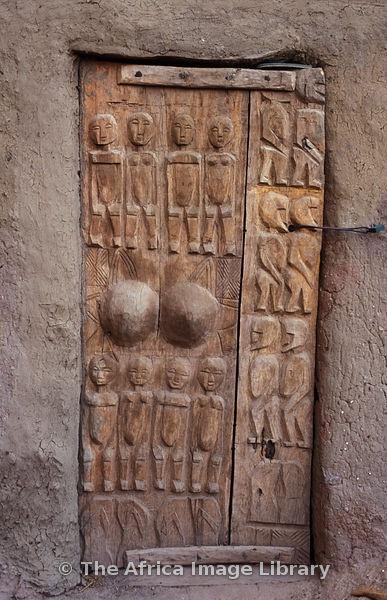 Traditionally carved dogon door, Ireli village below Bandiagara escarpment, Dogon Country, Mali