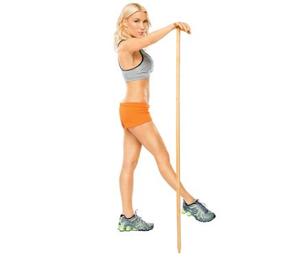 Gwyneth Paltrow's Broomstick Workout (seriously). This is the Kick & Reach: Stand with feet hip-width apart, stick at right side, right hand on top, right leg extended low in front of you, right foot turned out (as shown). Use stick for balance as you lean forward from hips, extending right leg high and to right behind you, left hand toward floor. Return to start; do 20 reps. Repeat on opposite side.