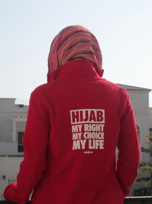 Woman in Jacket that Reads : Hijab, My Right, My Choice, My Life - Islamic Quotes About Hijab | IslamicArtDB.com