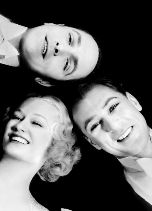 Miriam Hopkins in pre-code Design for Living (1933) is torn between two lovers (Gary Cooper and Fredric March) and she chooses....BOTH!