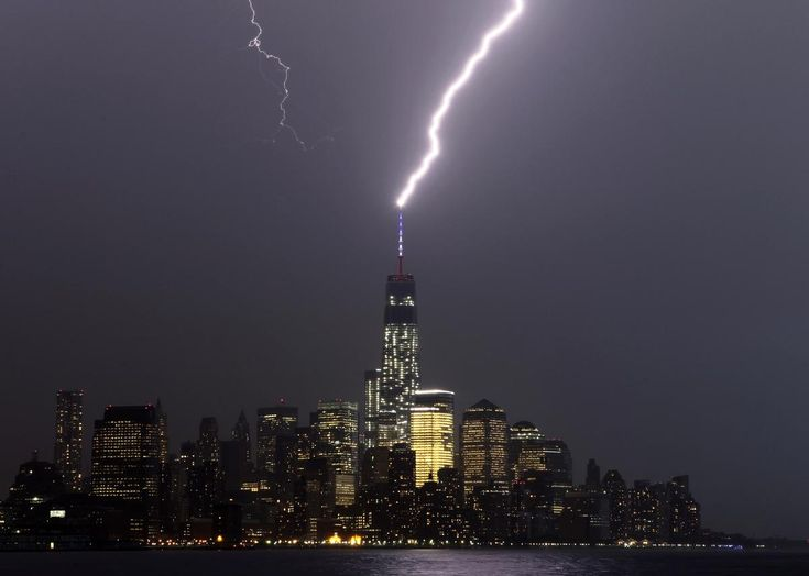 A bolt of lightning hits the antenna on top of One World Trade Center in Lower Manhattan on May 23 as an electrical storm moves over New York. (Gary Hershorn/EPA)