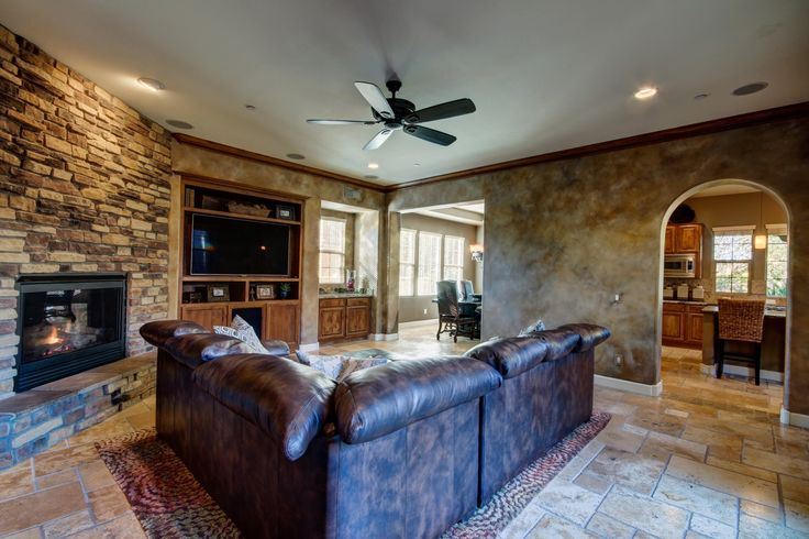 Living room, open, media station, stone fireplace