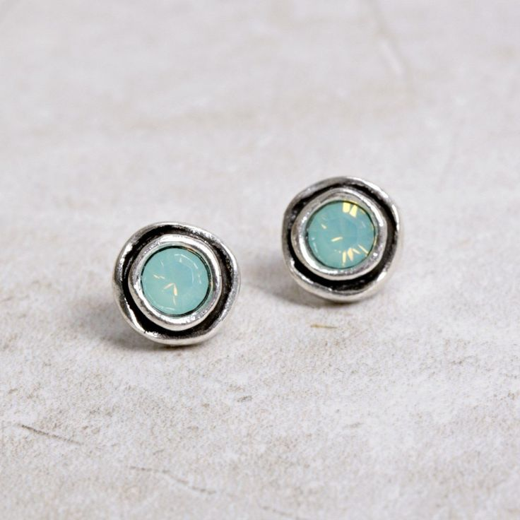 These pretty silver and Pacific Opal earrings by Patricia Locke are as lovely as they are light. They are a breeze to wear, add them to your jewel box today! An