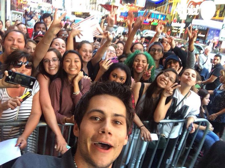 Dylan taking a selfie with fans