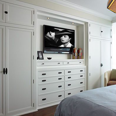get rid of the closet at the end of the hallway, extend our master closet space and turn it into his & hers built-ins with dresser space and TV. Gorgeous!