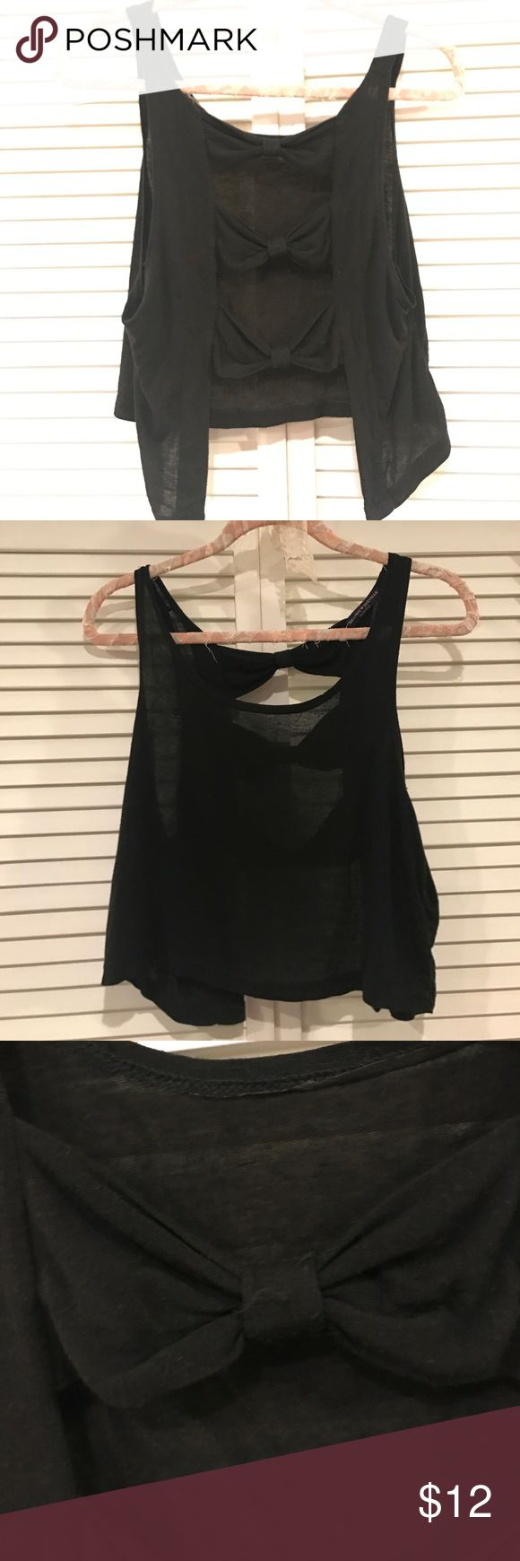 Brandy Melville Bow Back Tank Black BM tank with bows in the back. Great condition. Loose fit. One size fits most. Brandy Melville Tops Tank Tops