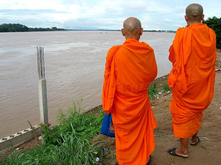 Monks on the Mekong River, Thailand: http://www.ytravelblog.com/daily-travel-photo-monks-on-the-mekong-river-thailand/ #travel