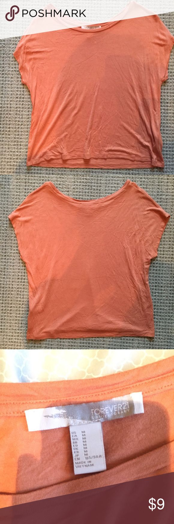 Orange Short Sleeve Top Very soft and comfortable orange short sleeve top. Kind of a boxy/cropped fit. Perfect for summer time or under a cardigan. Only worn once! Forever 21 Tops Tees - Short Sleeve