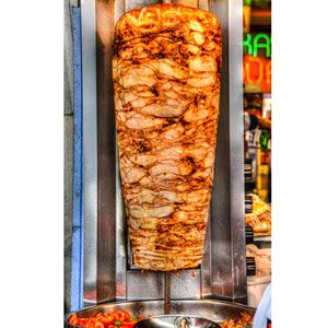 Döner Kebab; Turkey  grilling popularized in Turkey is döner kebab (or kebap). Using this method, meat is cooked on a vertical spit so the succulent juices run all the way down the length of the meat. Traditionally the meat cooked in this fashion is lamb, but today in Turkey it's common to find beef and lamb in combination, only beef, or even chicken. Pieces of meat are beaten and then seasoned, usually with suet (raw beef or lamb fat), as well as with a variety of herbs and spices.
