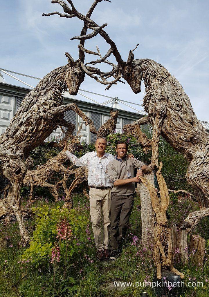 James Doran-Webb, driftwood sculptor (left) and John Bishop (plantsman) on the Doran-Webb sculpture stand, at the RHS Chelsea Flower Show 2017.
