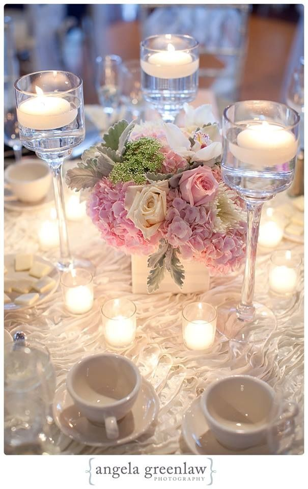 tall trio of stemmed candle holders with lush low arrangement in the centre Shelley…..isn't this gorgeous?!!!!