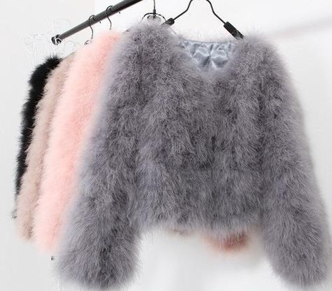 Furry knitted sweaters in grey, pink, light brown and black.