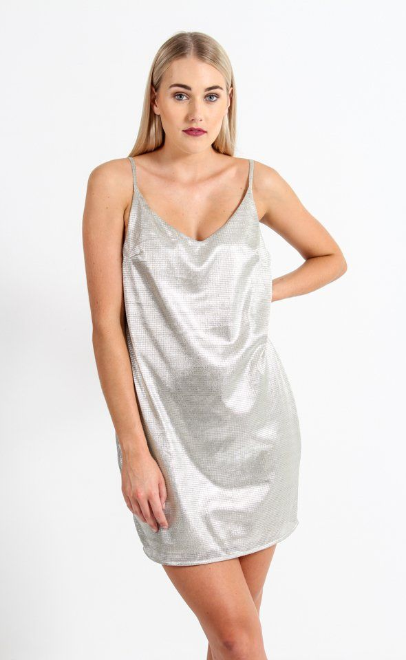 Make a statement in this glitter dress, featuring a relaxed shift cut and thin straps for an ultra-sleek style. Pair with subtle accessories for outfit perfection.