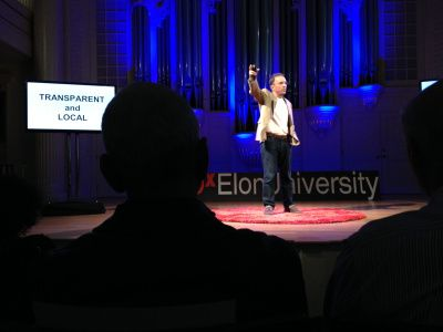 Eric Henry speaks about TS Designs and the flaws in today's apparel manufacturing business at a TEDx event on Elon University's campus.
