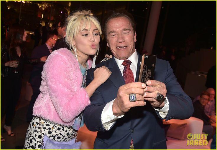 miley cyrus hangs with her ex dad arnold schwarzenegger 01
