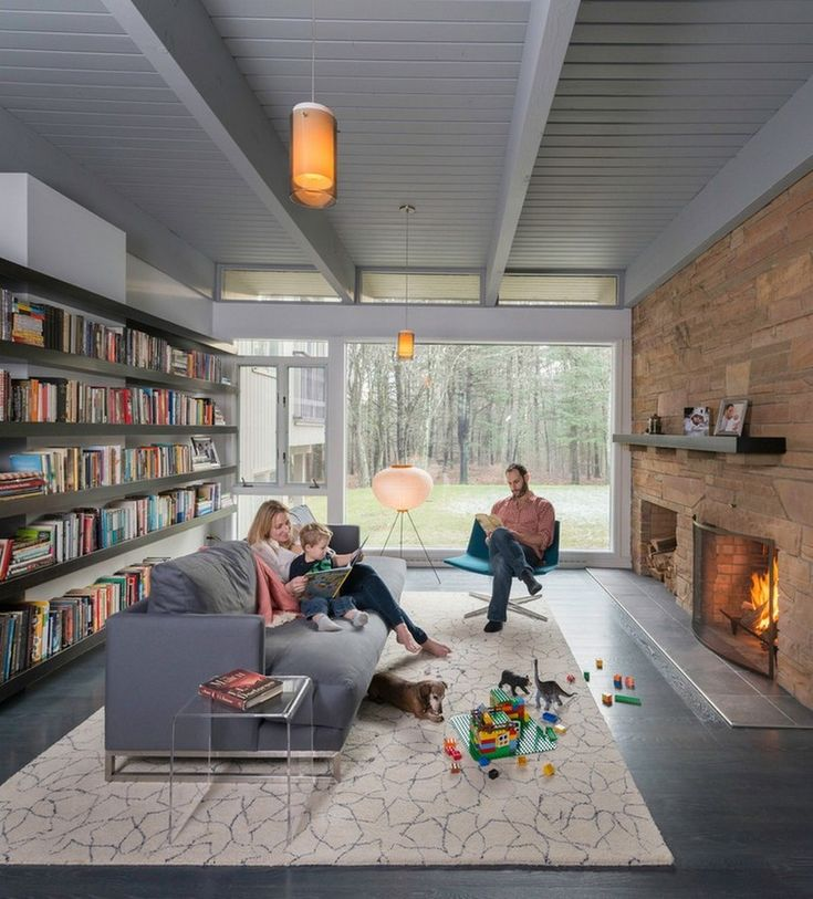Interior: Mid Century Modern Library With Grey Comfy Sofa. Rustic Stone Fireplace Also Modern Book Shelves