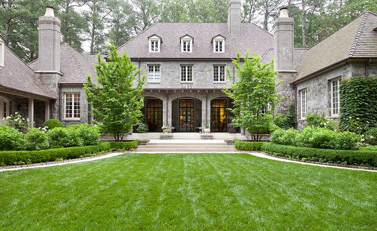 Howard Design Studio-love the stone arches on the back porch