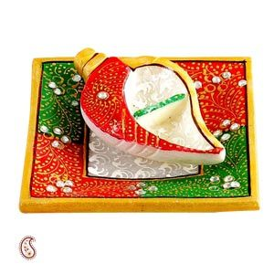 Shankh Shape Kumkum Container in White Marble Beautiful kumkum rice tilak container crafted in a shankh shape from pure white marble and lined in glossy red and green enamel with gold touches brighten up you home. Rs. 375 ($6.20) http://www.tajonline.com/diwali-gifts/product/d3832/shankh-shape-kumkum-container-in-white-marble/?aff=pint2013/