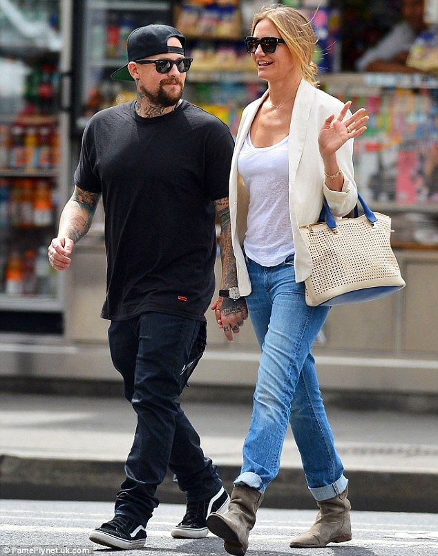 Hand-in-hand: Cameron Diaz and boyfriend Benji Madden looked loved up as they strolled thr...