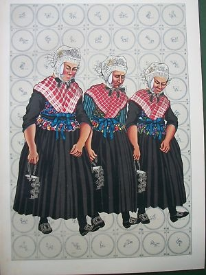 Staphorst Netherlands Costume in their hand they wear the bible decorated with silver on the book with a chain .