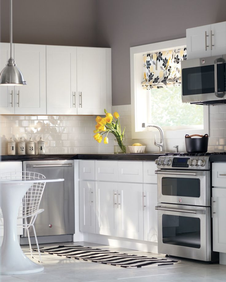 White cabinets subway tile gray walls perfection for Grey and white kitchen cabinets