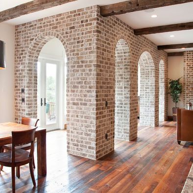 I'm in love with this type of character in a home....Whitewashed Brick interior archways