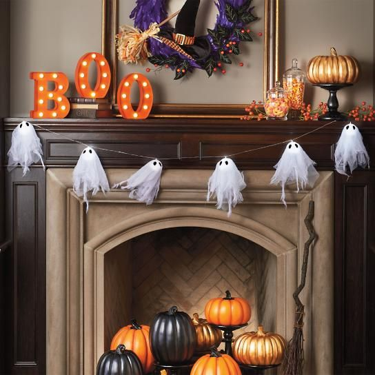 halloween decorations mantles cape with floating ghosts boo letters pumpkins on display and