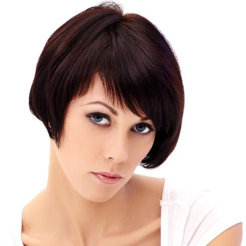 Another cropped bob with blunt bangs, this is a great short hairstyle for thick hair. Full hair is cut into a rounded profile with soft face framing layers. The asymmetrical bob is completed with angled bangs. (I like the angled bangs)