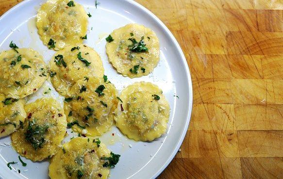 Homemade Ravioli using homemade ravioli pasta dough with a Greek ravioli stuffing dressed in a butter lemon sauce. Raviolies