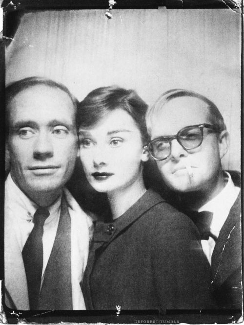 Audrey Hepburn, Mel Ferrer, + Truman Capote. in a photobooth.