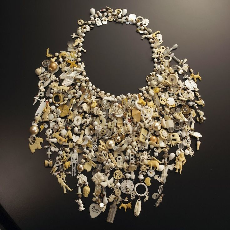 jewelsallaround:  Robin Ayres – White Noise necklace. This one has over 1,500 pieces and is not for the faint of neck. I've also made black, red, periwinkle, navy and all celluloid. Contains cracker jack charms, hardware, bone, vintage glass beads, mother of pearl