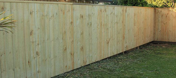 Plain board with a U mould cap wooden (timber) fence