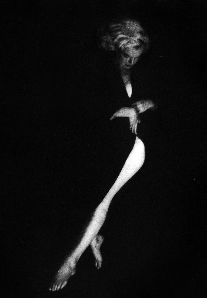 Marilyn. Black cardigan/nude sitting. Photo by Milton Greene, 1953.