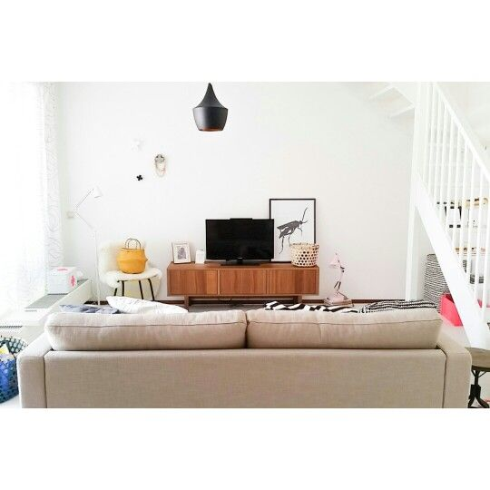 Our living room. I like the nordic feeling with the white floor.