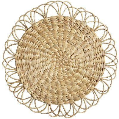 Our water hyacinth placemat proves that petal power endures. Woven in Indonesia by expert artisans, the bursting bloom features a solid disk surrounded by a ring of delicate, airy petals. Add simple dinnerware and bright napkins for a showy tabletop display.