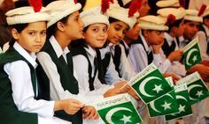 Pakistani schoolchildren hold national flags during a ceremony to celebrate the 65th Independence Day in Peshwar, north-west Pakistan, this morning.
