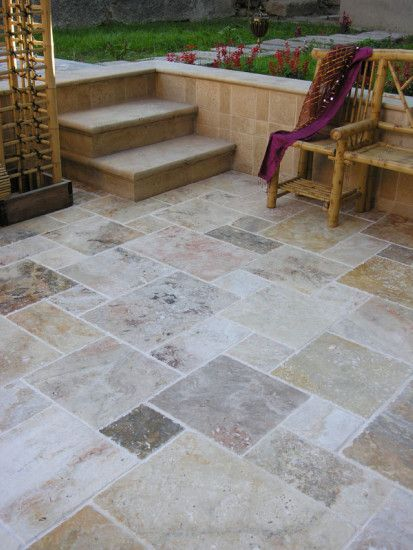 Smooth concrete taped off and stained in patchwork of natural colors. DIY and affordable.