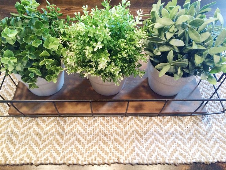 Neutral table runner with wire basket and greens makes a perfect farmhouse table centerpiece. This is easy to throw together and so trendy. The pops of green are stunning. Kitchen table inspiration.
