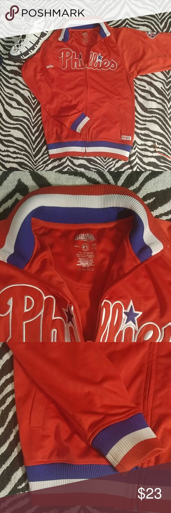 "Philadelphia Phillies dugout jacket S Beautiful Phillies jacket made by Stitches. This is officially licensed genuine MLB Merchandise in very nice condition. Light-medium weight with awesome embroidered logos. Men's size S Length 26"", Width 20"" Jackets & Coats"