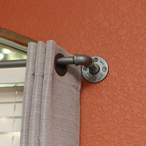 This curtain rod was designed to compliment nearly any decor. Many color options and sizes are available. This listing is for the extra-long version of our popular curtain rod, and includes up to two center supports (depending on length) for added strength across long distances. Pipe Curtain Rods can also be used as a retail fixture, as a metal rod to support lighting or as a metal decor piece to hang picture frames. These curtain rods look great with a variety of decor including industrial…