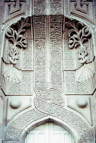Image TUR 0430 featuring facade from the Ince Minare Medrese, in Konya, Turkey, showing Geometric PatternFloriated Arabesque and Calligraphy using carved masonry or stone relief.