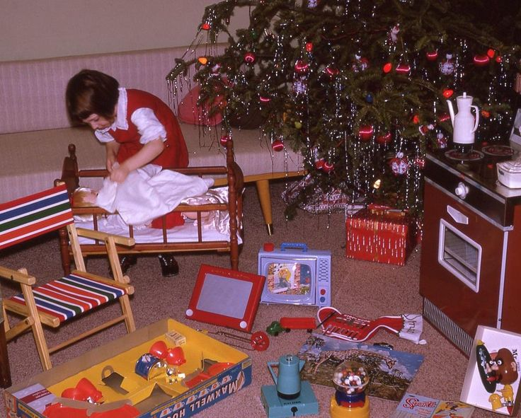 Christmas 1965---Isn't it sweet how the little girl is tending to her baby doll?