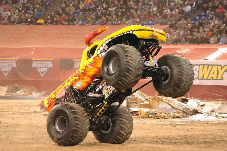 yellow monster jam truck   wheelie