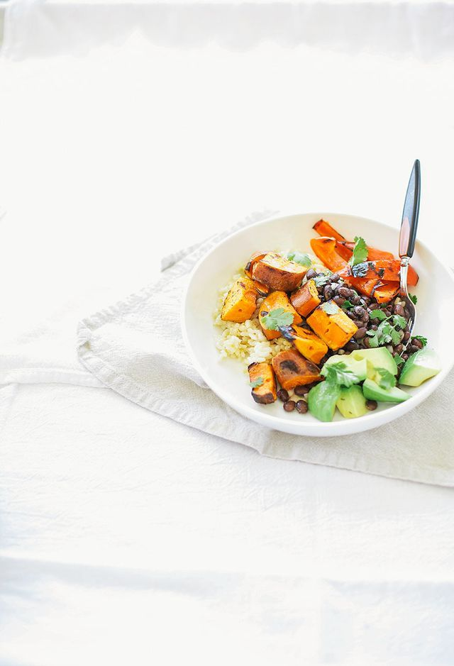 {Grilled sweet potato and black bean burrito bowl.}