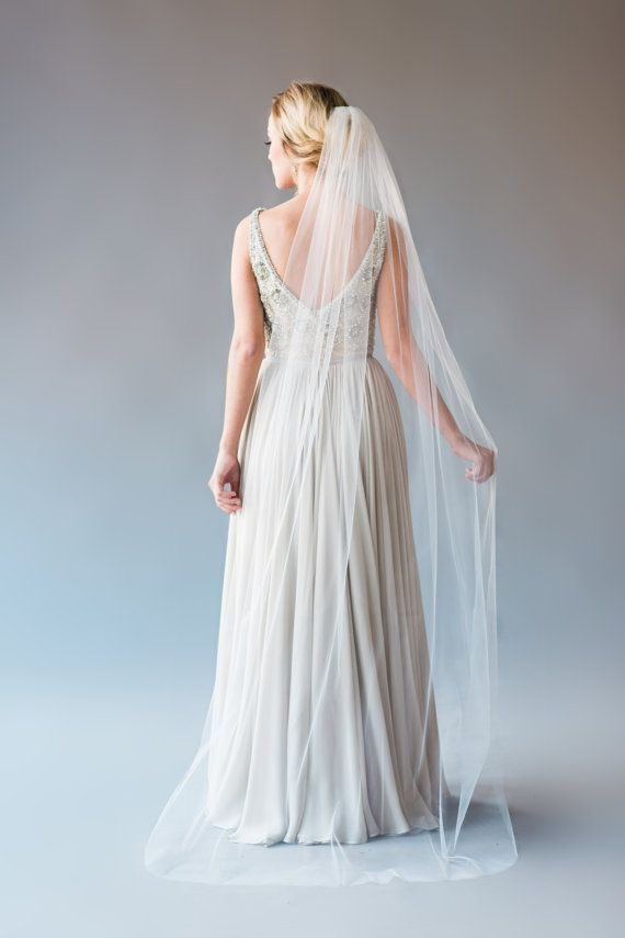 CATHERINE VEIL DESCRIPTION: single tier chapel length veil Veil is made of soft bridal illusion tulle and has a raw cut rounded bottom edge.