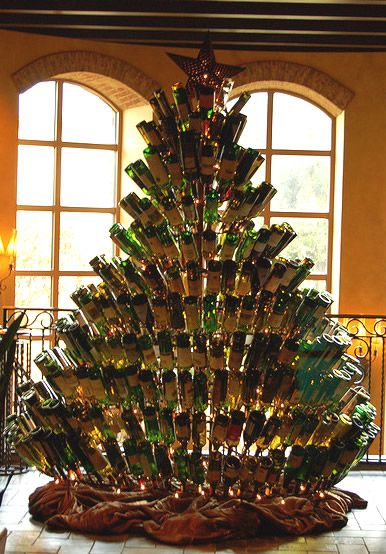 Wine Bottle Christmas Tree...could probably use the bottles that came with the corks used to make a bath mat...
