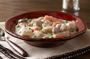 Slow-Cooker Pantry Chicken Stew recipe - A busy weekday calls for a soothing dish to come home to. Heart-warming chicken and veggies in a creamy chive & onion sauce has family fave written all over it. #slowcookerrecipes