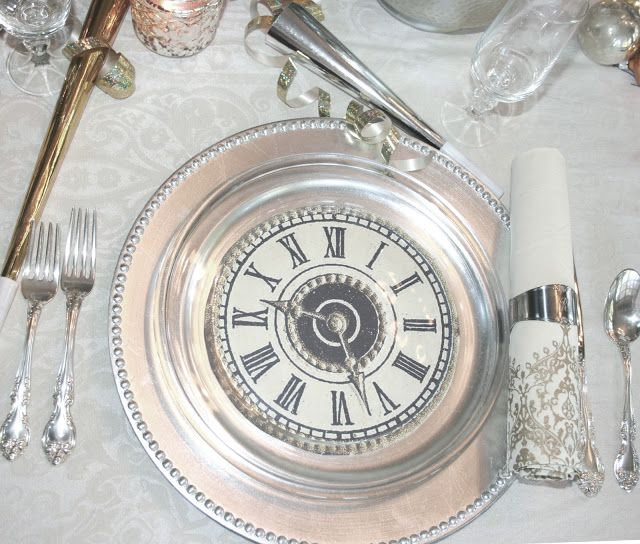 Printed clock faces sandwiched between glass plates set on a silver charger (ciao! newport beach: a new year's eve dinner).